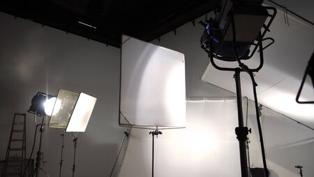 Studio light and back drop and soft box set up for shooting photo or video production which includes flashlight and continue lighting on tripod and paper background and used for photographer or videographer 版權商用圖片 - 147860948