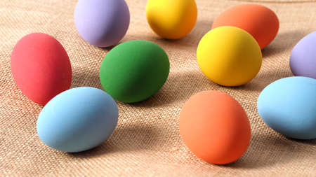 Multi-colorful of easter eggs on background in studio with close-up shot which include many colour such as yellow, green, blue, purple, red covered on eggs by art painting