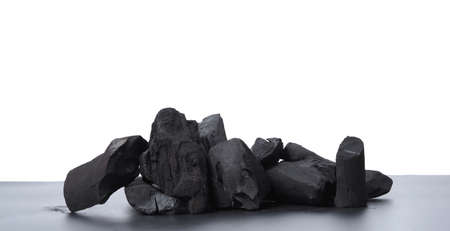 Group of charcoal black color made from real wood in studio close-up shot which use for cooking or absorb odor in room or refrigerator. And use in some cosmetic industry.
