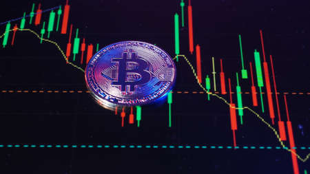 Close up bitcoin and digital stock market graph bar on black. Cryptocurrency. Bitcoin Stock Growth. Investing in virtual assets. Investment platform with charts and bitcoin coin. digital money. 免版税图像