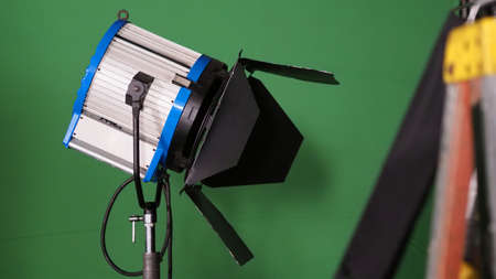 Studio light equipments for photo or film movie video. Light set for professional shooting and screen background. LED Flood light and Spot light for video production. Setup include Barn door softbox. 免版税图像