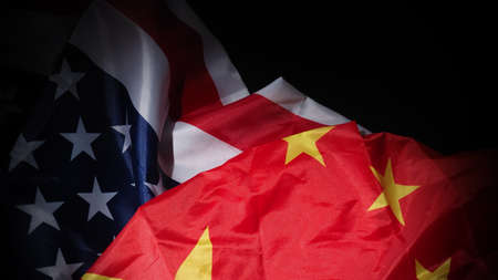 USA and China flag on black background. Represent serious trade tension or trade war between America and China. financial concept. Flags of China and the United States of America on Black. top view angle. 免版税图像