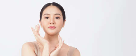 Beauty and skin concept. Young asian woman beauty face make up for skincare cosmetic and showing natural wellness soft and firm and ageless facial skin. younger looking youthful. real acne no retouch. 免版税图像