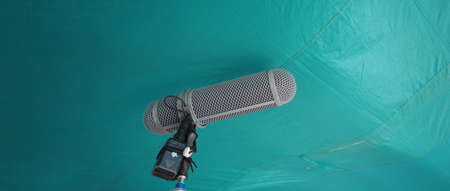 Microphone boom type. Sound recorder boom mic and tripod stand. Professional digital audio recording gear mic for making film or video movie production. Wind protection on boom mic. Movie industry