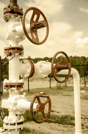 wellhead: Wellhead with valves. Oil and gas concept. Toned.