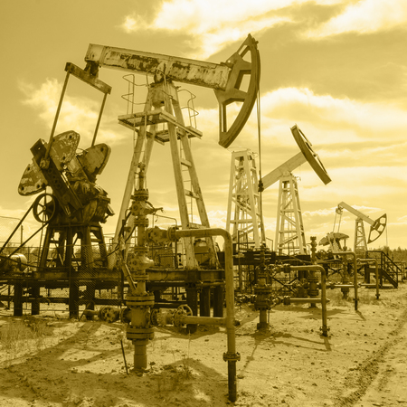 wellhead: Group of pump jack and wellhead in the oilfield. Oil and gas concept. Toned.