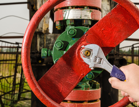 wellhead: Wellhead valve repair with the wrench. Oil and gas concept. Stock Photo