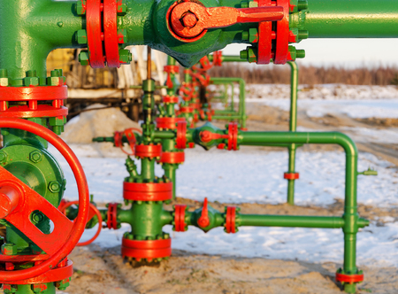 fuel and power generation: Group of wellheads. Oilfield during winter time. Oil and gas concept.