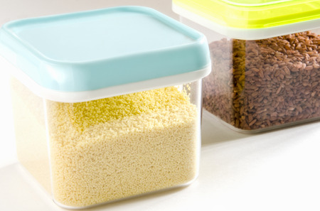 food storage: Food storage. Food ingredients (cous cous and brown rice) in plastic containers. Selective focus.