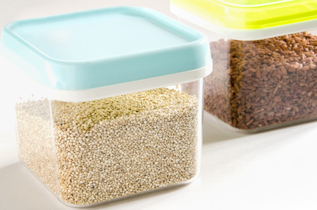 food storage: Food storage. Food ingredients (quinoa and brown rice) in plastic containers. Selective focus.