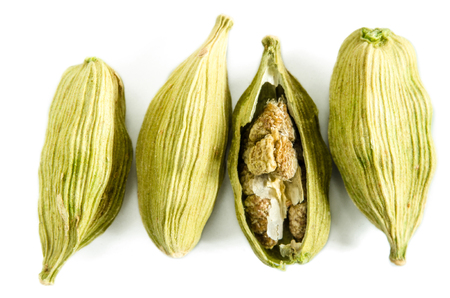 Dry cardamom seeds isolated on white. Food background. Closeup macro shot. Top view. Stock Photo
