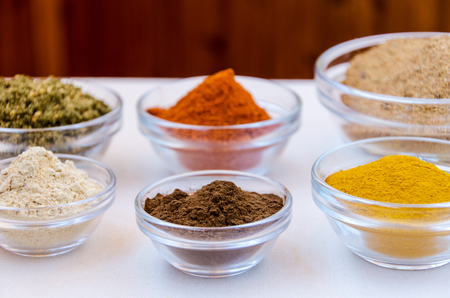 Different kind of colorful spices powder in glass bowls. Food and cuisine additives.