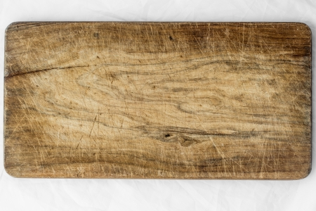 wood cut: Old and used natural wooden cooking board with cuts