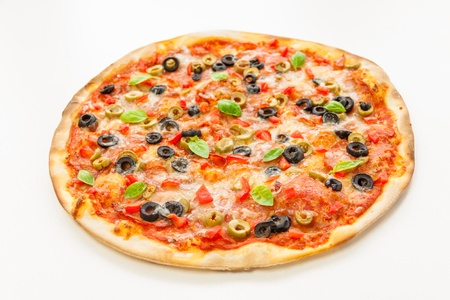 Beautiful multi colored and crispy pizza with basil, melted cheese and salami slowly turning on rotating table with white background