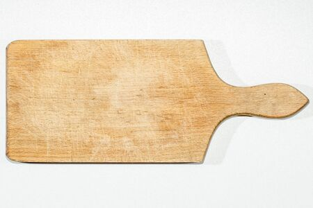 Old used kitchen wooden cutting board with scratch marks photo