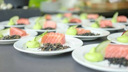 plating: A line of freshly plated salmons and cucumbers with pyre