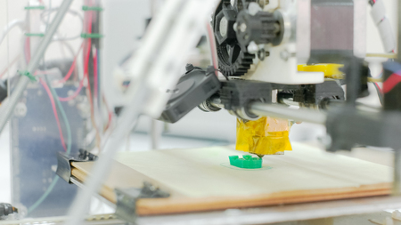 three layered: Detailed view at 3D printer in work Stock Photo