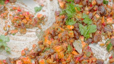 Close up shot of vegetarian food being cooked on huge pan