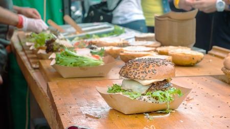 make public: Finished burger on the table, higher angle