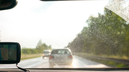 Car being driven fast on the highway road after rain Zdjęcie Seryjne