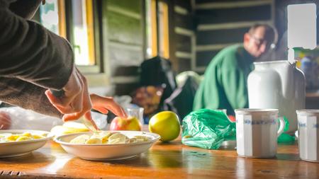 Woman preparing healthy morning breakfast in the mountain cabin