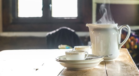 Smoke coming out of the tea pot set, genuine breakfast dishes in the travelers cabin