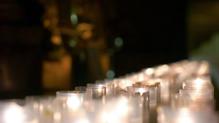 Detailed row of candles grouped together on the christian altar