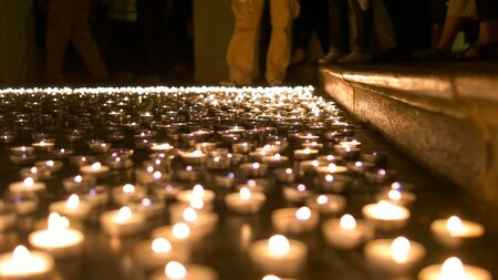 Candles placed on the floor of church during night of the churches event