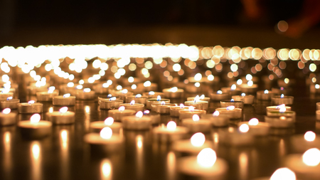 Candles lights lit and burning during night of the churches event