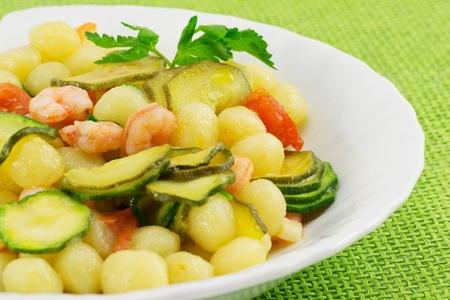 Gnocchi with shrimp and zucchini photo