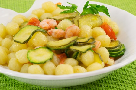 Gnocchi with shrimp and zucchini Stock Photo