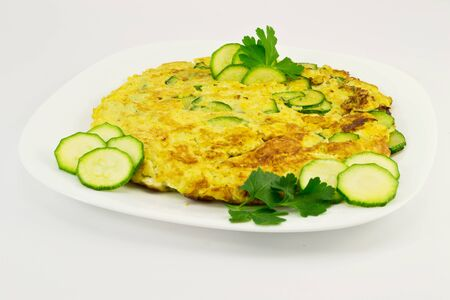 Omelette with zucchini photo