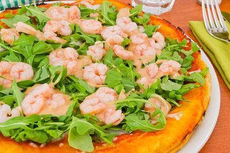 pizza with arugula and shrimp with  photo