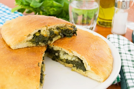 pizza stuffed with spinach and mozzarella photo
