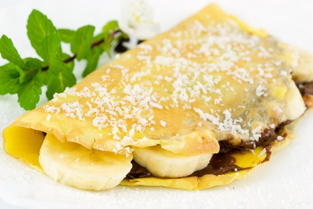 crepes filled with chocolate, banana and coconut photo