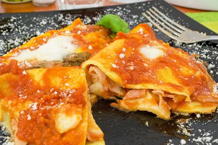Crepes stuffed with ham and mozzarella photo