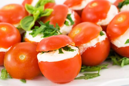 tomatoes stuffed with cheese  photo
