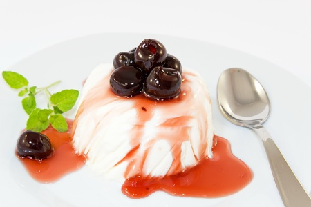 panna cotta with black cherry syrup