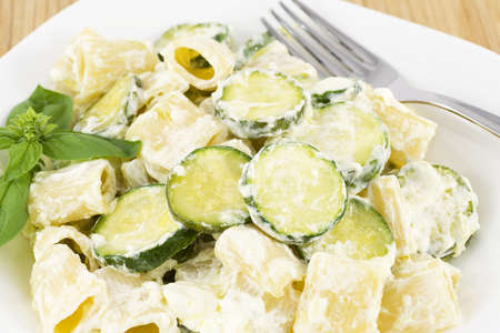 short pasta: short sleeves with zucchini and philadelphia  Stock Photo