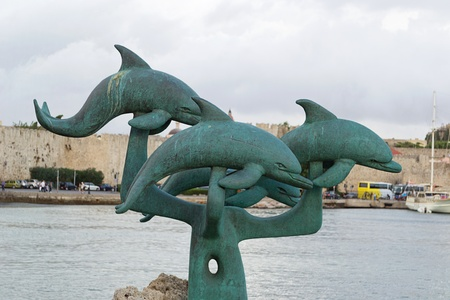Dolphins, monuments to the port of Mandraki-Rhodes, Greece Imagens