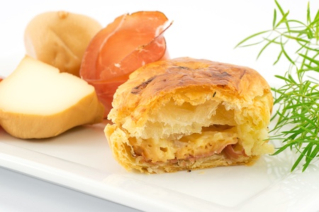 puff pastry stuffed with bacon and smoked cheese photo