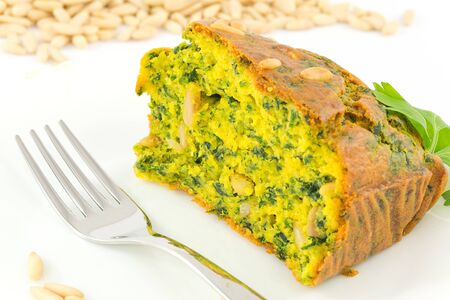 pine nuts: cake with spinach and pine nuts Stock Photo