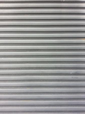 steel: Gray steel garage door with horizontal lines.