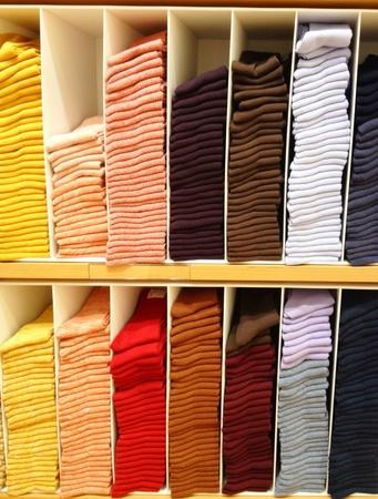 cotton fabric: Arrangement socks in shelves Stock Photo