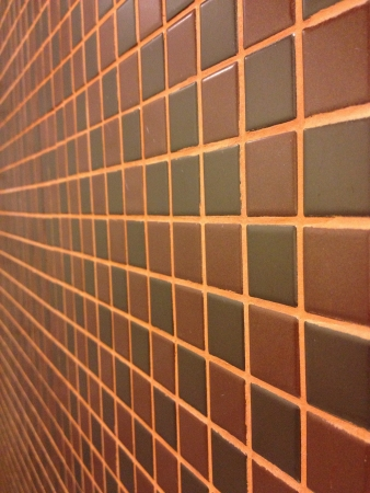 tile: Brown mosaic tile texture with orange filling