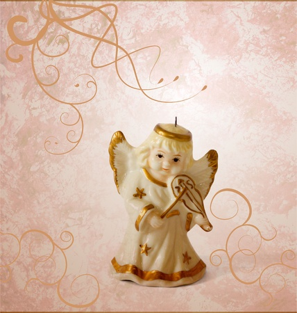 angel with violin decor on grunge brown background photo