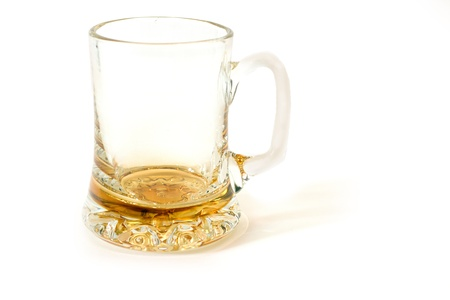 yellow glass mug for beer isolated on white photo