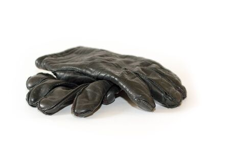 a rair of dark warm winter gloves isolated on white Stock Photo - 13279221