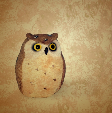 vintage style owl on grunge retro brown background photo
