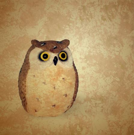 vintage style owl on grunge retro brown background photo